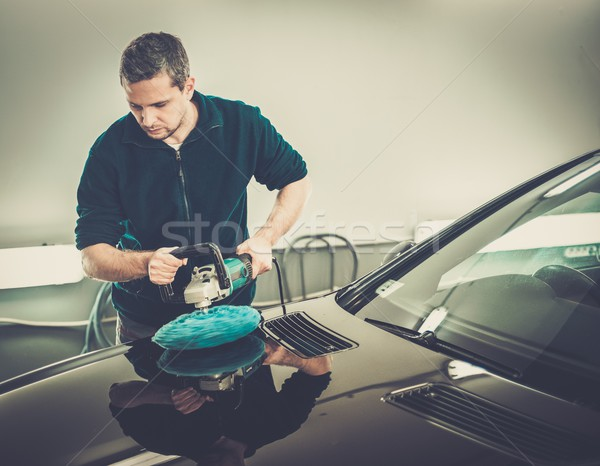 Man on a car wash polishing car with a polish machine  Stock photo © Nejron
