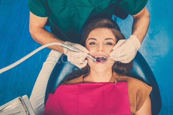 Young beautiful brunette woman at dentist's surgery  Stock photo © Nejron