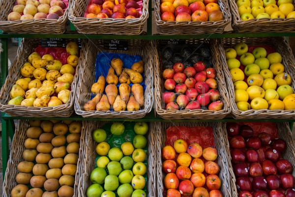 Fruits in baskets on market place Stock photo © Nejron