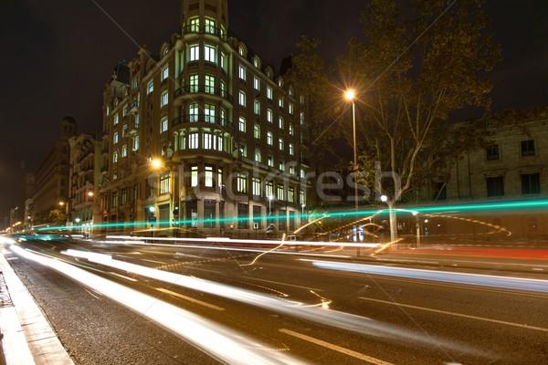 Street of Barcelona at night wtih blurred cars Stock photo © Nejron