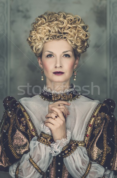 Picture of beautiful haughty queen in royal dress Stock photo © Nejron