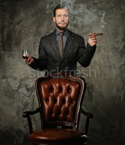 Handsome well-dressed with glass of beverage and cigar Stock photo © Nejron