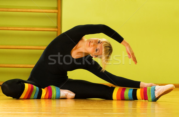 Ballet dancer doing stretching exercise on a floor Stock photo © Nejron