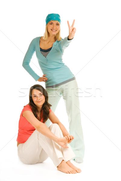 Two teenage girls isolated on white background Stock photo © Nejron