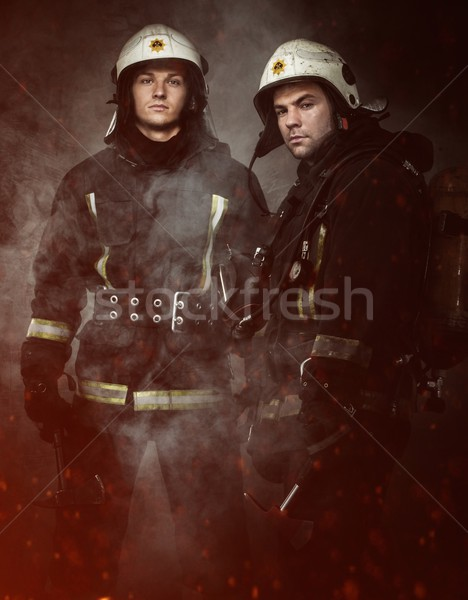 Two firefighters with axes in a smoke Stock photo © Nejron