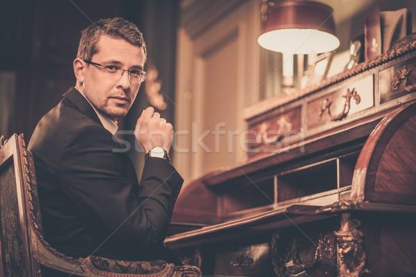 Confident middle-aged man in luxury vintage style interior  Stock photo © Nejron
