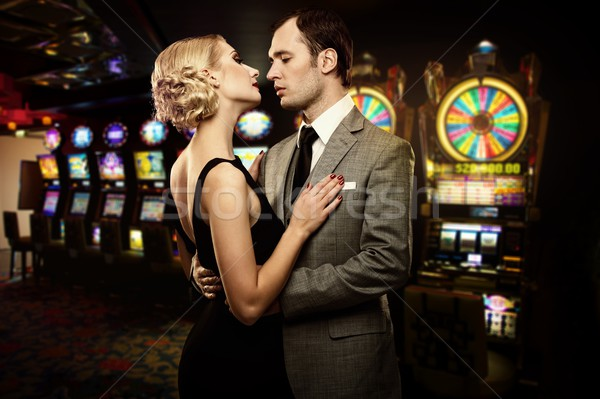 Retro couple against slot machines Stock photo © Nejron