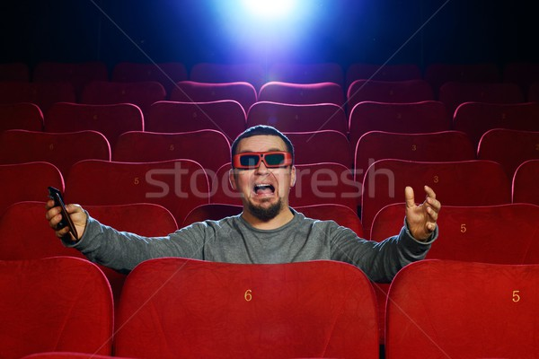 Funny  man in 3D glasses watching movie in cinema Stock photo © Nejron