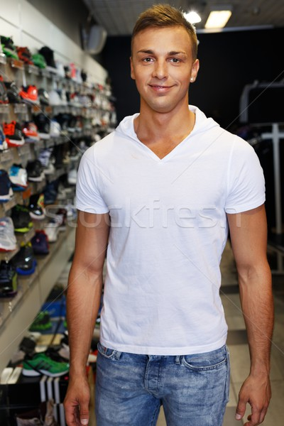 Handsome young man in a sport outlet Stock photo © Nejron