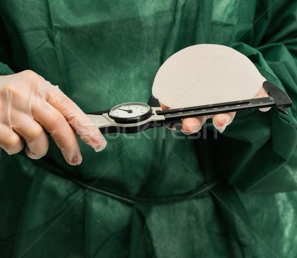 Plastique chirurgien mains silicium sein Photo stock © Nejron