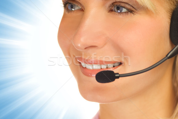 Beautiful hotline operator with headset on abstract background Stock photo © Nejron