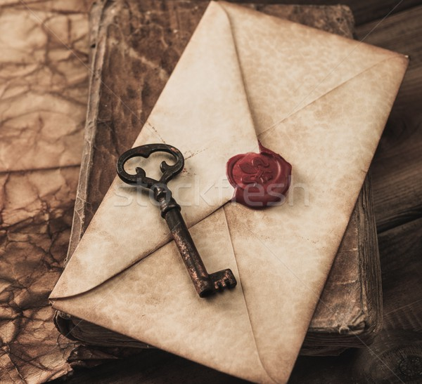 Old key and envelope on a vintage book Stock photo © Nejron