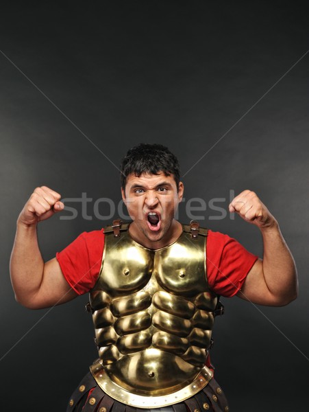 Legionary soldier showing his strength Stock photo © Nejron