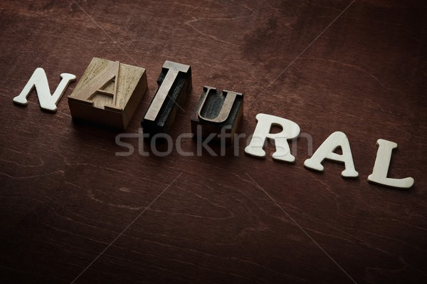The word natural written on wooden background Stock photo © Nejron