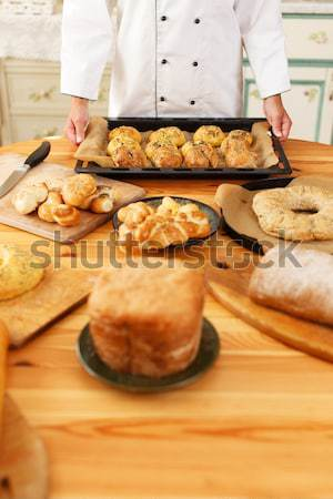 Woman hands holding baking tray with homemade baked goods Stock photo © Nejron