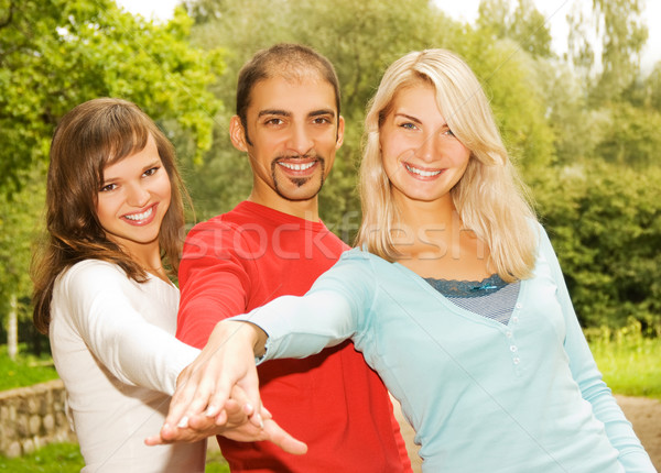 Group of young people put hands on top of each other Stock photo © Nejron