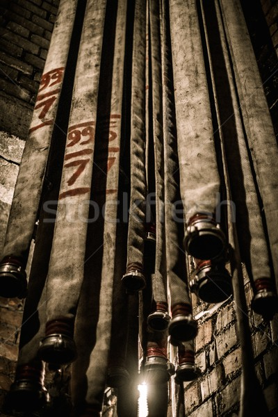 Storage room in firefighting depot with water hoses  Stock photo © Nejron