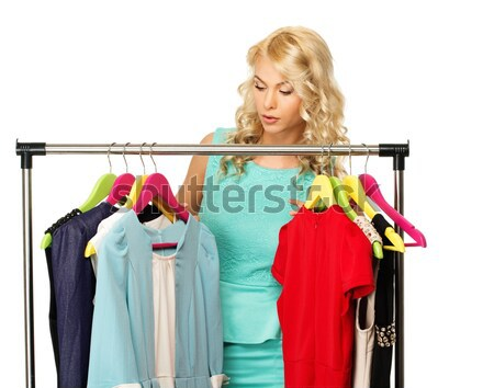 Blond woman choosing clothes on a rack  Stock photo © Nejron