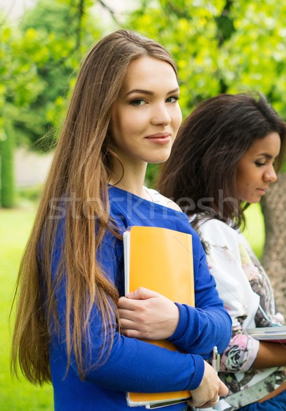 Multi ethnic girls students in a city park  Stock photo © Nejron