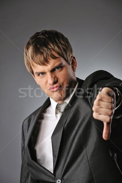 Businessman showing his thumb down  Stock photo © Nejron