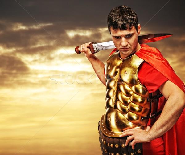 Roman legionary soldier against cloudy sky Stock photo © Nejron