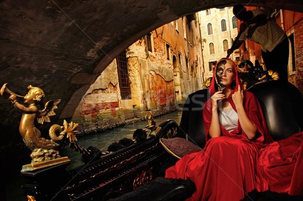 Beautifiul woman in red cloak riding on gandola Stock photo © Nejron
