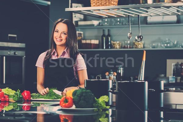 Alegre mulher jovem avental moderno cozinha Foto stock © Nejron