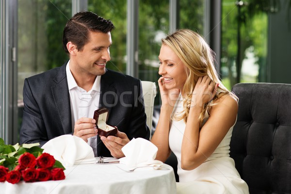 Man holding box with ring making propose to his girlfriend Stock photo © Nejron