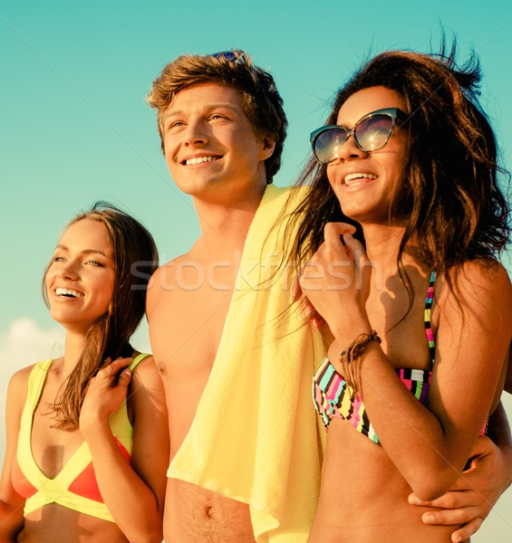 Group of multi ethnic friends walking on a beach Stock photo © Nejron