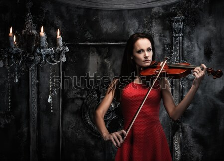 Tattooed beautiful woman in old spooky interior Stock photo © Nejron