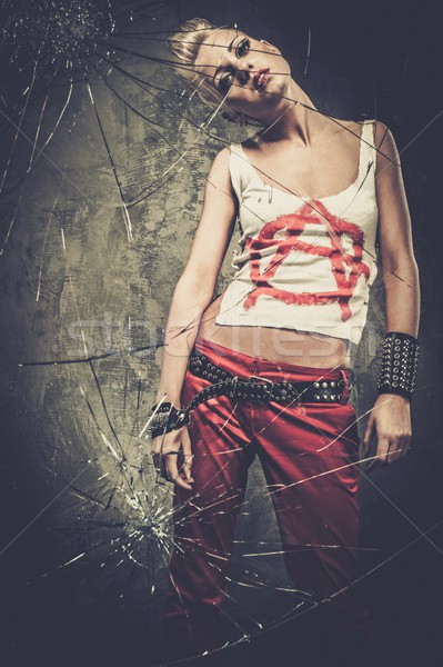 Punk girl behind broken glass  Stock photo © Nejron