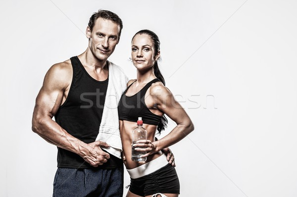 Athletic couple after fitness exercise Stock photo © Nejron