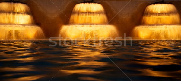 Stock photo: Three water cascades at night.