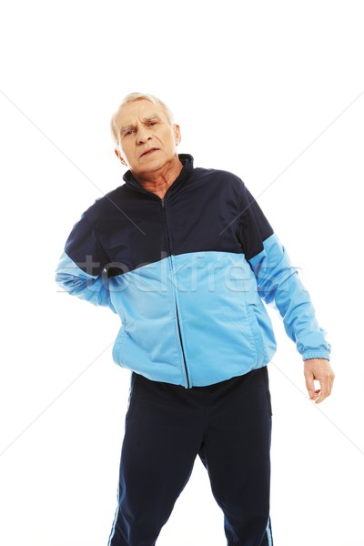 Senior man in training suit feeling pain in his back   Stock photo © Nejron