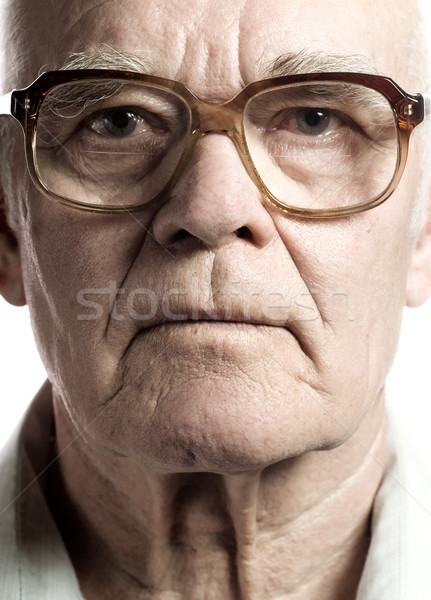 Elderly man with massive glasses Stock photo © Nejron