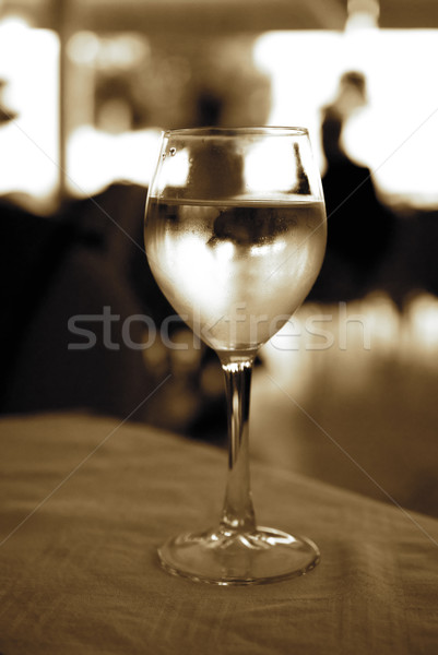Glass of white wine on a table (toned in sepia) Stock photo © Nejron