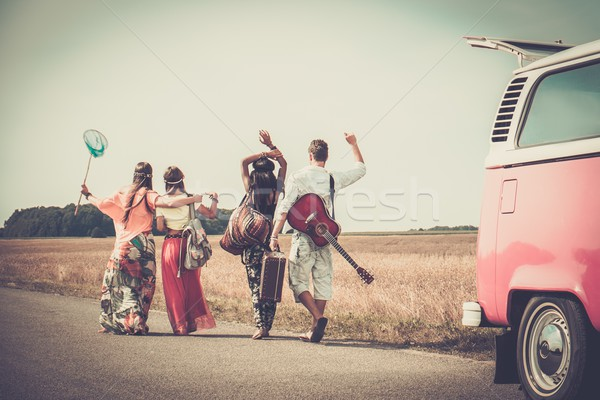 Multi-ethnic hippie friends with guitar and luggage  Stock photo © Nejron