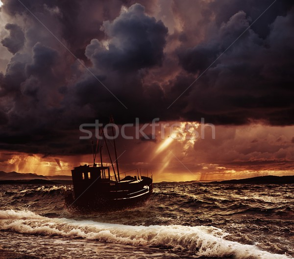 Fishing boat in a stormy sea  Stock photo © Nejron