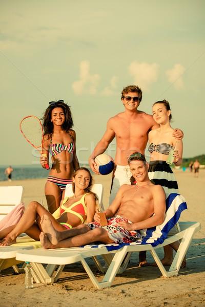 Csoport többnemzetiségű barátok labda ütő tengerpart Stock fotó © Nejron