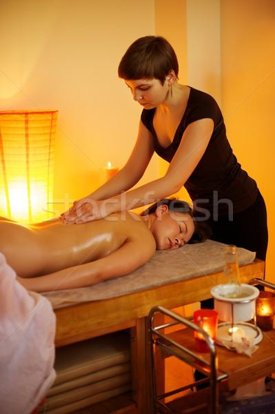 Beautiful woman having a massage Stock photo © Nejron