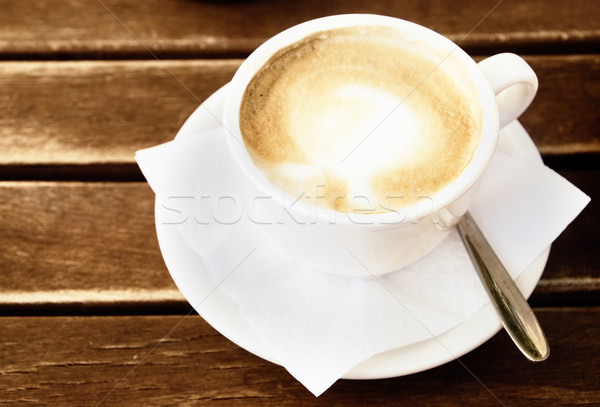 Coffee cup on wooden table (toned in sepia) Stock photo © Nejron