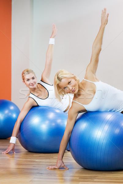 Group of people doing fitness exercise with a ball Stock photo © Nejron