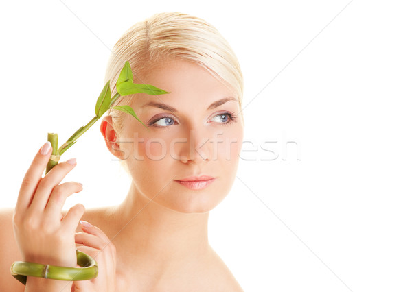 Beautiful young woman with a bamboo plant Stock photo © Nejron