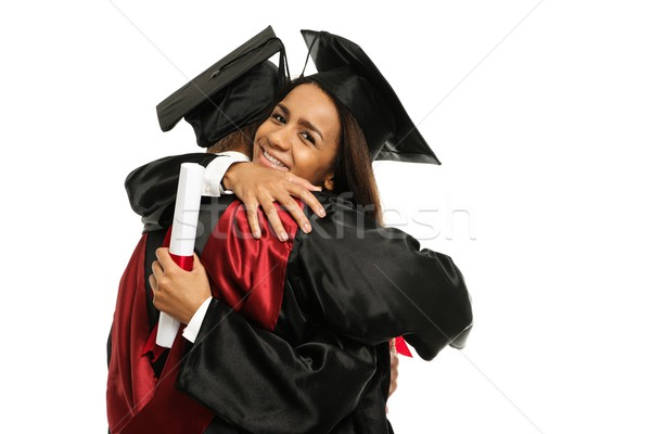 Happy graduated young multi ethnic students couple hugging  Stock photo © Nejron