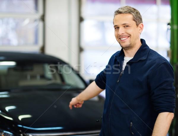 Cheerful man on a car wash Stock photo © Nejron