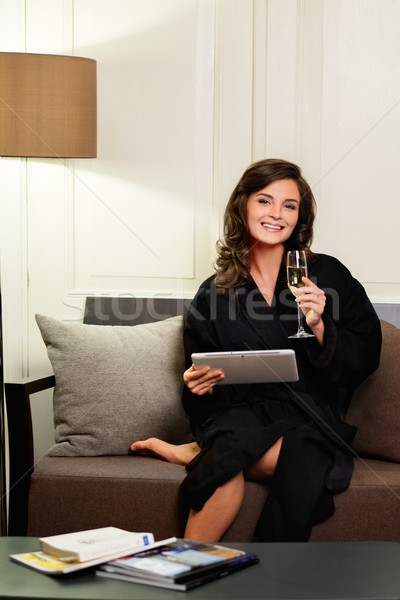 женщину халат расслабляющая стекла шампанского Сток-фото © Nejron