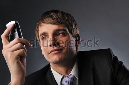 ストックフォト: ハンサム · 小さな · ビジネスマン · 話し · 携帯電話 · 顔
