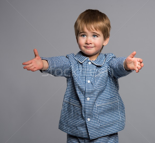 Weinig jongen Blauw pyjama armen breed Stockfoto © Nejron