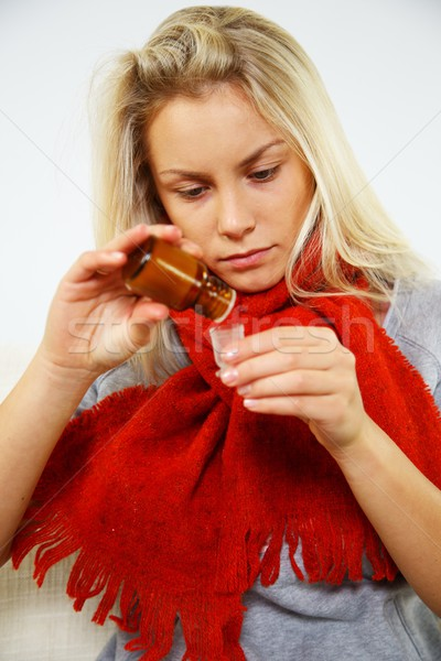 Sick young blond woman with bottle of mixture Stock photo © Nejron