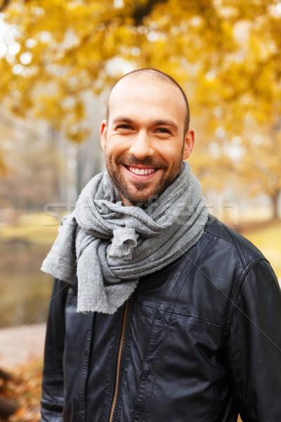 Positive middle-aged man alone on beautiful autumn day Stock photo © Nejron